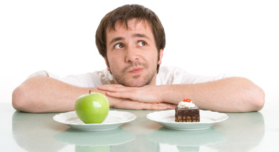 photo of a man with cake and an apple