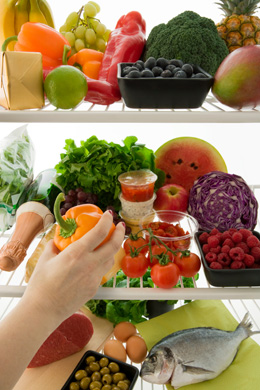 photo of a fridge full of fresh food